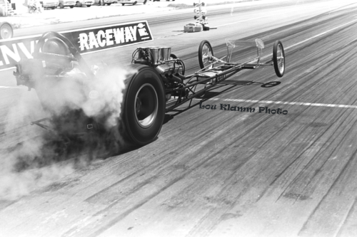 P 88 Dragster at starting line smoke